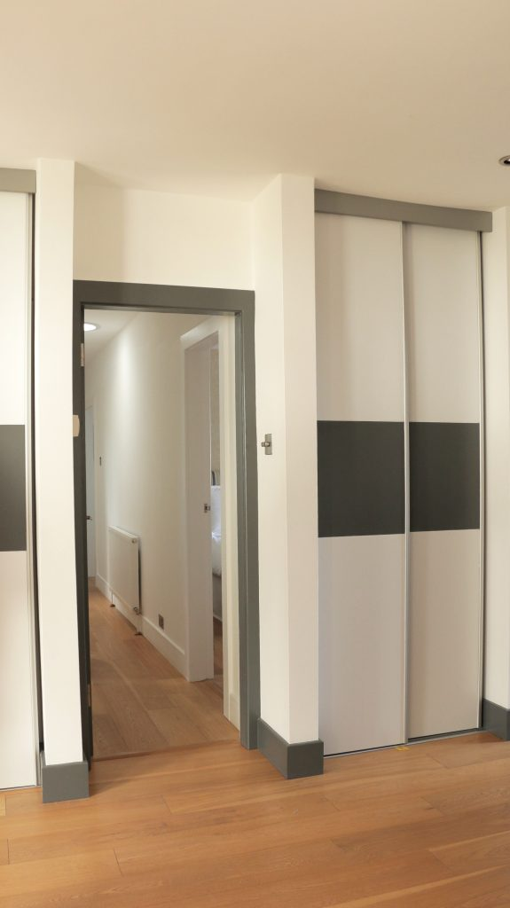 Minimalistic Interior Design for hall with built in wardrobes