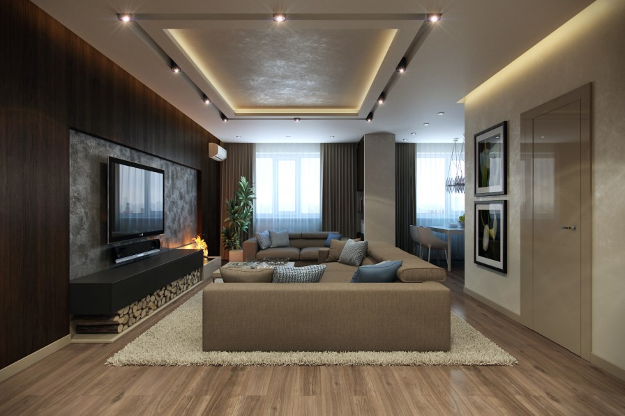 Modern Lounge with large sofas and wall fitted TV