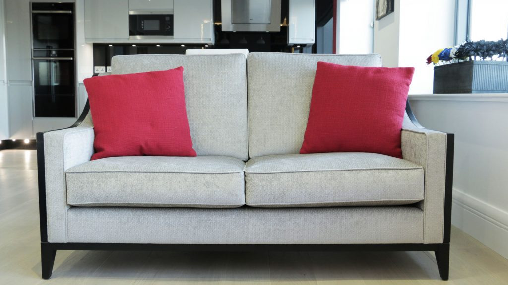 Cut to size grey sofa in open plan kitchen lounge
