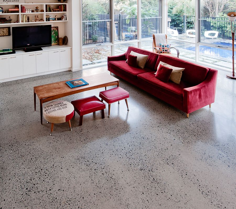 concrete floor with red furniture - interior design example